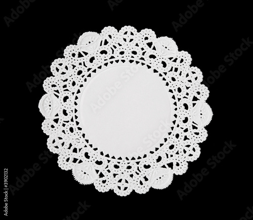 Fényképezés  A decorative round doily isolated over black