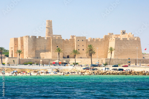 Poster Tunisia View of beach against Ribat in Monastir