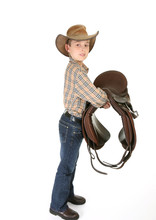 A Young Horse Rider Holding A ...