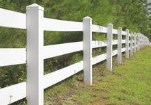 A Decorative White Split Rail Fence.