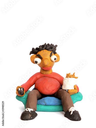Photo  Plasticine man watching TV