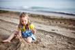 Kid playing on beach