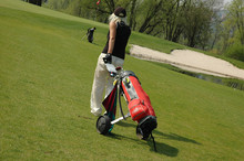 Golf Player With Bag