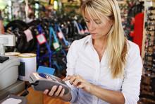 Young Woman Using Debit Card M...