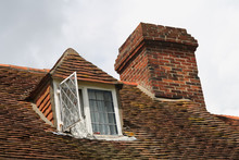Old Style Dormer Windows And Chimney