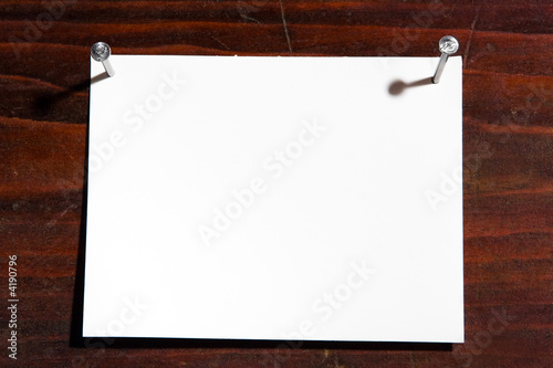 white frame nail to wooden background
