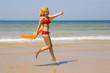 Girl runs on beach