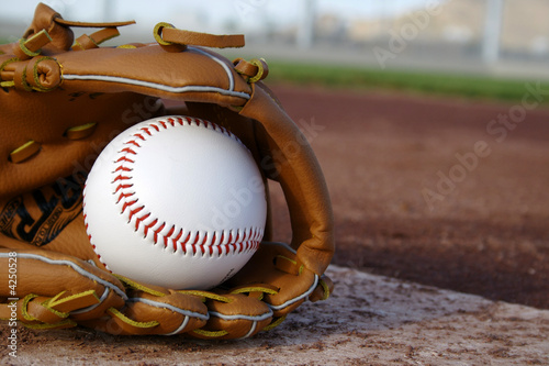 Photo  Baseball & Glove on Baseball Field