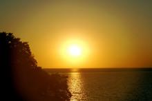 Full Orb Sunset Over Lake