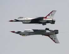 The USAF Thunderbirds Opposing Solos Fly Mirror Formation