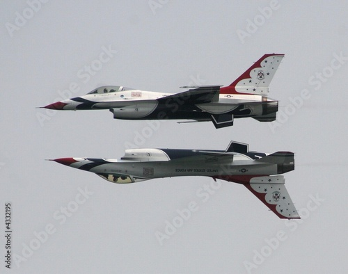 Photo The USAF Thunderbirds opposing solos fly mirror formation
