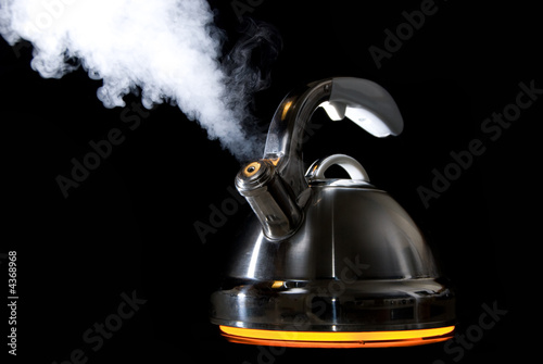 Fotografija  Tea kettle with boiling water on black background
