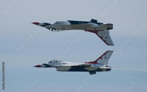 Fototapeta Two Thunderbird jets flying inverted