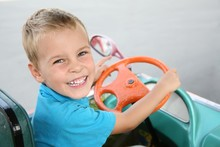 Smiley Boy Steering In The Toy Car