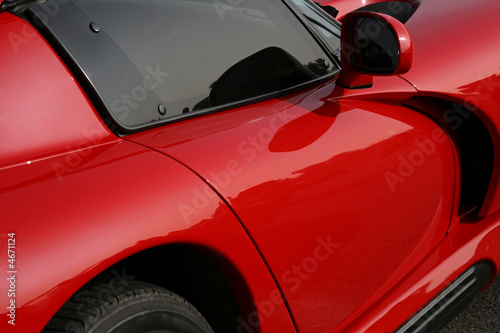 side of red exotic car