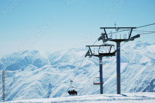 Fotobehang Wintersporten Ski lift chairs on bright winter day