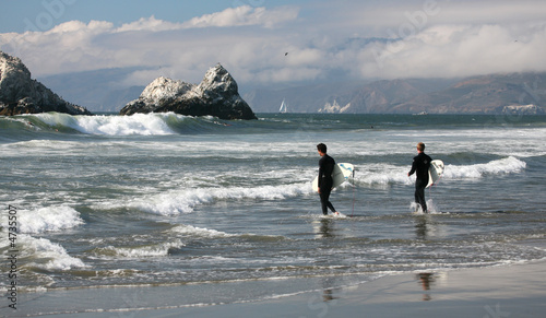 Fotobehang Antarctica Surfeurs sur la côte de Californie