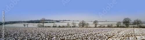 Aluminium Prints Dark grey warwickshire farmland covered in snow winter