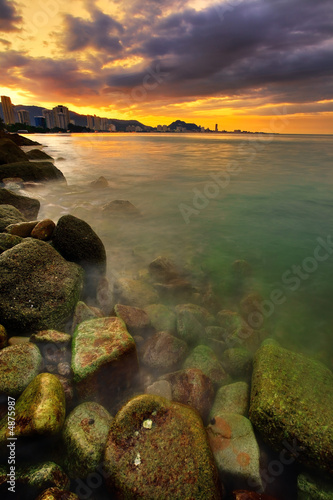 Foto-Kissen - Sunset over city and ocean