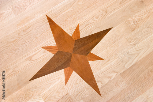 Valokuva  compass rose inlaid in wood, background