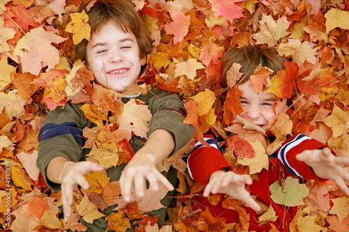 Photo  Boys Playing in the Leaves