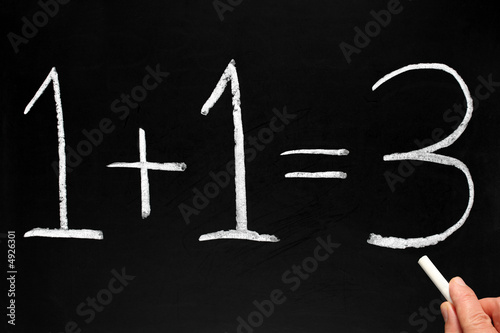 Writing 1+1=3 on a blackboard. Canvas Print