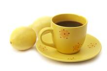 Yellow Coffee Cup And Lemons.jpg