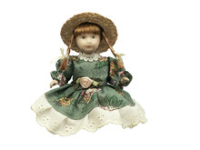 Doll With Old-fashioned Straw On White Background