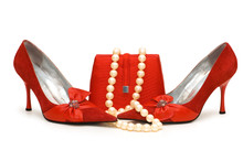 Red Shoes, Purse And Pearl Necklace Isolated