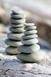 Balancing rock towers on the beach, California