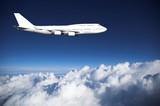 Fototapeta Fototapeta z niebem - Jumbo jet  above clouds