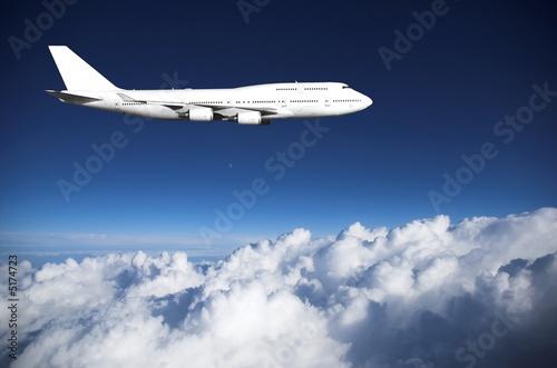 Fotografia  Jumbo jet  above clouds