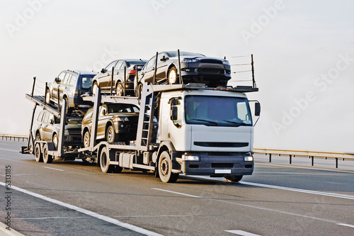 Fényképezés  car carrier truck deliver batch to dealer trucks series