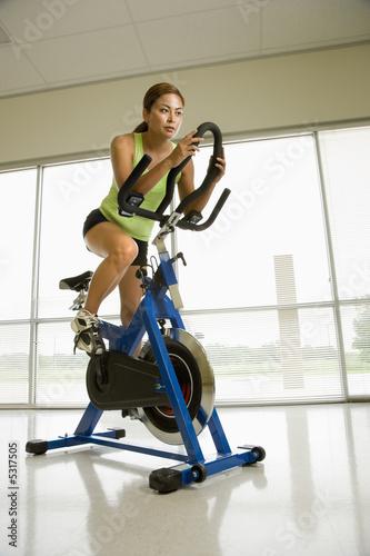 Fotografie, Obraz  Woman exercising on bike.