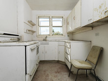 Empty Dirty Kitchen.