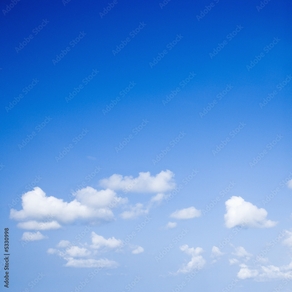 Blue sky with some white puffy clouds.