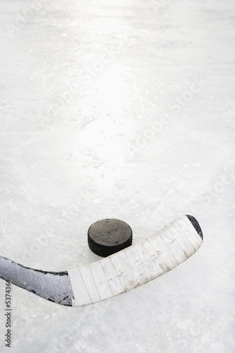 Photo  Close up of ice hockey stick on ice rink.