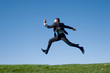 Leinwandbild Motiv Businessman jumping in the air