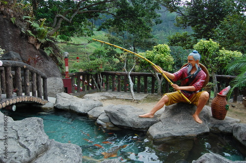 1143192d6f4 chinese old man fishing statue - Buy this stock photo and explore ...