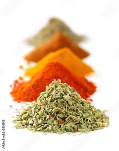 Foto op Plexiglas Kruiden Heaps of various ground spices on white background