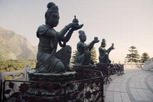 Buddhistic Statues Praising The Big Buddha In Lantau, Hong Kong