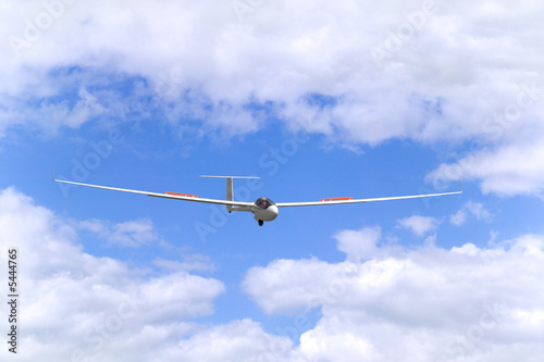 Modern glider in flight coming into land.
