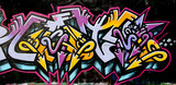 grafitti tag yellow and purple