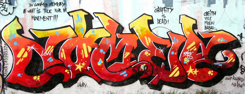 grafitti tag image with several taglines around © fnalphotos.com