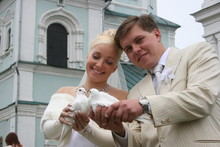 Newlyweds Coule Holds Pair Of ...