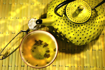 FototapetaGreen asian teapot with cup and green tea