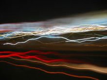 Abstract Light Trails From Cars, Signs, And Other Landmarks.