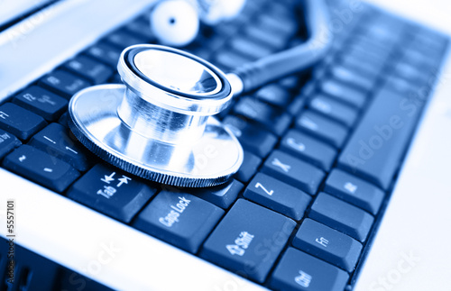 Fotografie, Obraz  Close-up of stethoscope on laptop keyboard