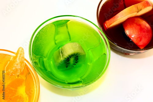 Fototapeta three fruit jelly kivi mandarin apple on white background obraz na płótnie