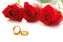 Three Roses And Rings Isolated On The White